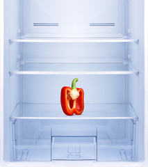 Red pepper in empty refrigerator.