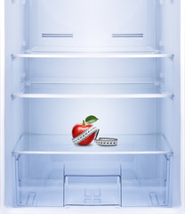 Apple with measurement  in empty refrigerator.