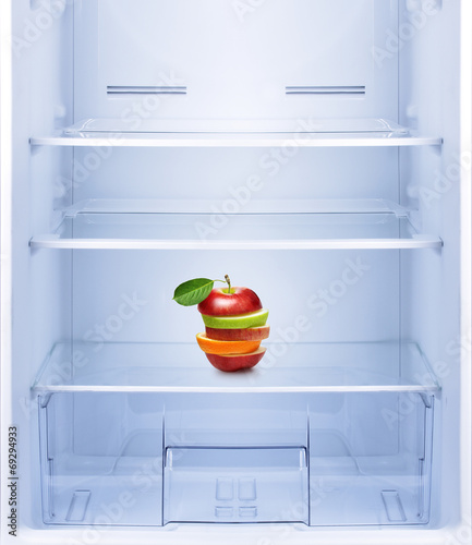 canvas print picture Apples and orange fruit in empty refrigerator.