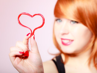 Redhair woman girl holding valentine red heart love.