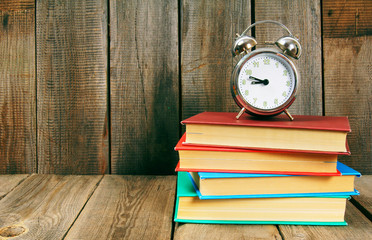 Back to school. Books and an alarm clock.