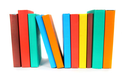 Multi-coloured books. On white background.