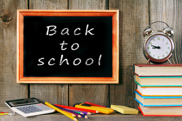 alarm clock, books and school accessories.