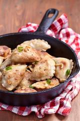 Dumplings fried with onion