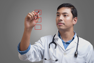 Young physician ticking the checklist boxes