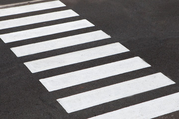 White stripes of a zebra crossing