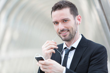 Portrait of an attractive businessman using handsfree set