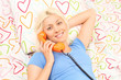 Blond woman speaking on the telephone