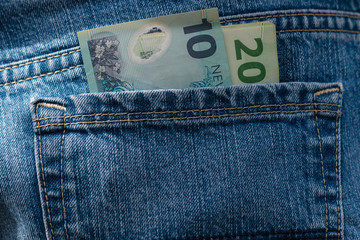 New Zealand dollars in pocket