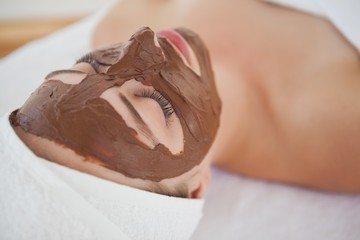 Beautiful blonde getting a chocolate facial treatment