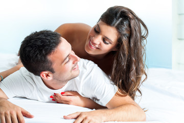 Young couple in bedroom.