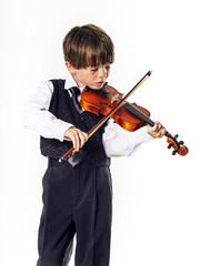 Red-haired preschooler boy with violin