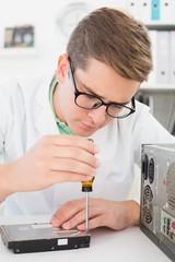 Technician working on broken hardware with screwdriver