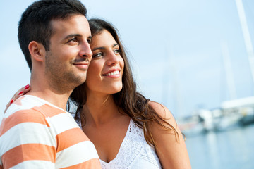 Young couple in harbor.