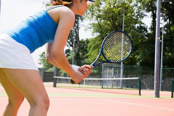 Tennis player standing on court