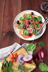 Tomato salad with fresh spinach,olives and red sweet onion.