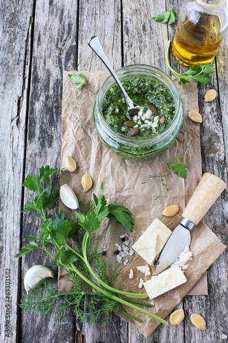 Papiers peints Condiment Delicious homemade pesto of green herbs with pumpkin seeds