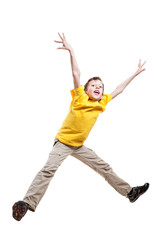 Funny little child in yellow t-shirt jumping in excitement