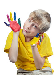 Beautiful funny child in t-shirt showing painted hands