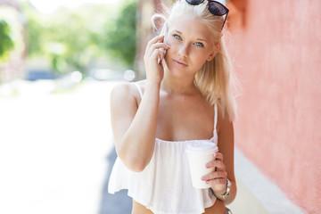 Teenage girl talking on the phone outdoor