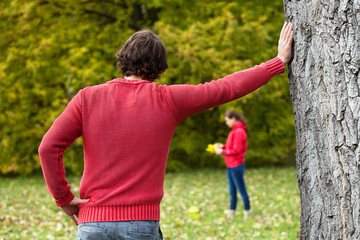 Man observing his girlfriend in park