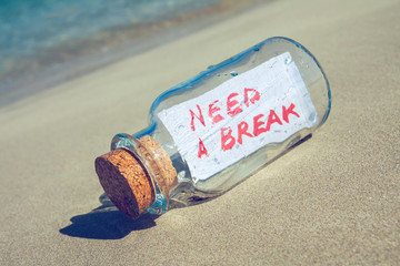 "Bottle with a message ""need a break"". Stress concept."