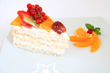Piece of sweet and tasty fruit cake with decoration