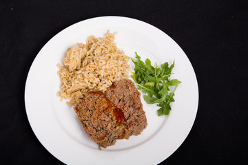 Meatloaf Rice and Arugula on Black