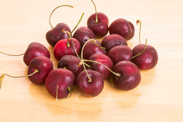 Red Cherries on a Wood Table