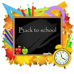 Back to school. Blackboard with school supplies.