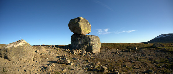 Big boulders on mountain plateau panoramic photo, Valdresflye, J