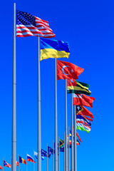 Flags against blue sky, copyspace