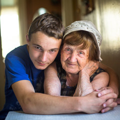 Close-up portrait of a grandmother and grandson.