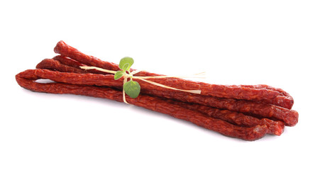 sausages decorated with basil and straw tape