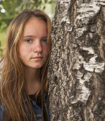 Pretty young girl in the birch forest.