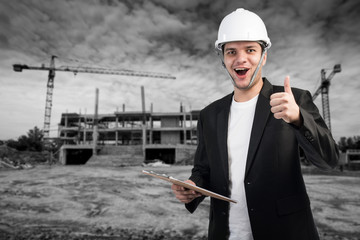 Successful engineer or architect, crane and building constructio