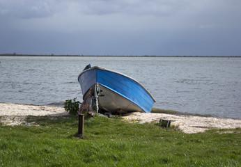 single-masted boat at seaside
