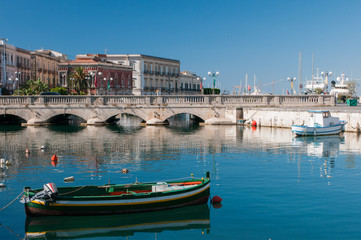 View of Umberto I bridge in Siracuse and fishing boats