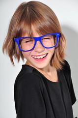 kid with glasses having fun