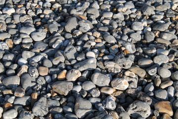A Background Image of Flint Type Pebbles and Stones.