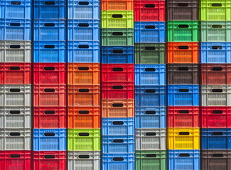 stack of colorful plastic boxes