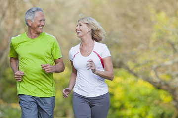 Smiling senior couple jogging