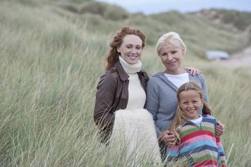 Multi Generation Family Walking Through Dunes