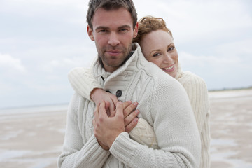 Romantic Couple Walking Along Winter Beach