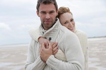 Romantic Couple Walking Along Winter Beach