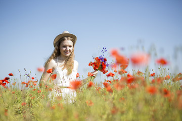Woman  at white dress found beatiful flower