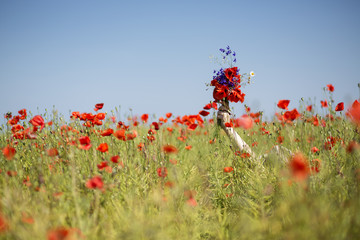 Woman  at dress drowns in poppy field