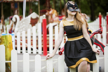 Woman  with mask on empty carousel background