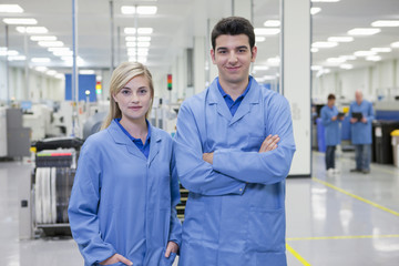 Portrait of smiling technicians in hi-tech manufacturing plant