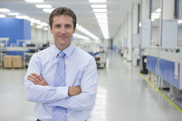 Portrait of smiling businessman in  hi-tech manufacturing plant
